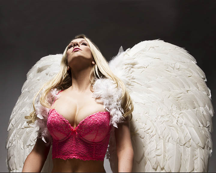 Boudoir portrait of a woman with angel wings, photographed by master photographer Mark Laurie who specializes in female nudes and boudoir images.