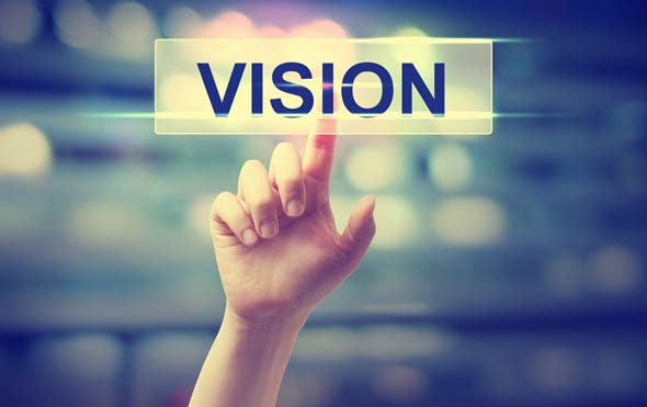 Vision concept with hand pressing a button on blurred abstract background